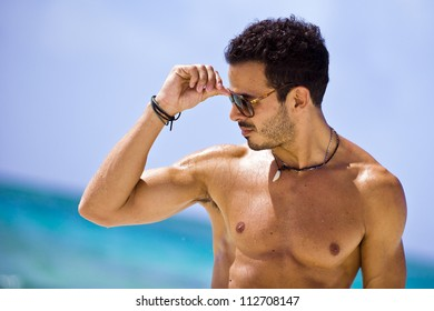 Portrait of an attractive young man on a tropical beach
