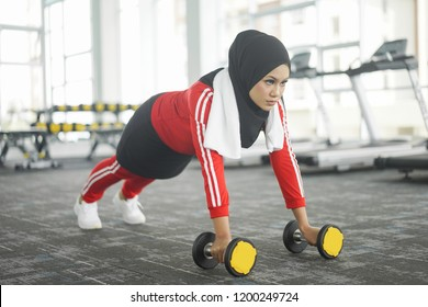 Portrait of attractive young Muslim woman workout in gym healthy lifestyle