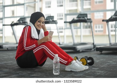 Portrait of attractive young Muslim woman smiling while workout in gym healthy lifestyle