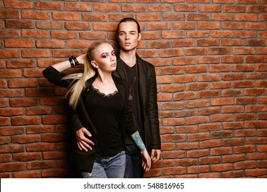 Portrait of an attractive young people in love. Beauty, fashion concept. Bright make-up, cosmetics.