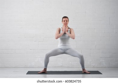 Portrait of attractive young woman doing yoga