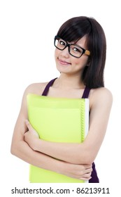 Portrait of an attractive young woman in eyeglasses hugging her folder over white background