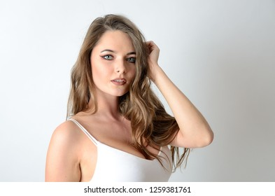 Portrait of attractive young woman. Female model with blond hairs and charming eyes.