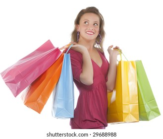 Portrait of an attractive young woman holding several shoppingbags.