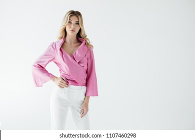 portrait of attractive young woman in pink blouse posing isolated on white