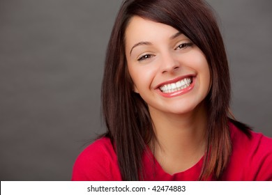 portrait of an attractive young woman in a red top.
