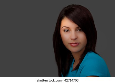 A Portrait of an attractive young woman with selective lighting.