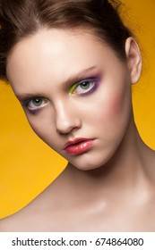 Portrait of attractive young woman with stylish colorful makeup
