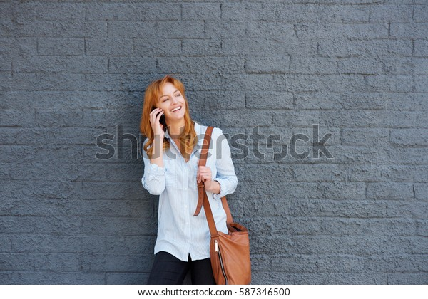Portrait of attractive young woman talking on smart phone