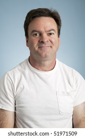 Portrait of an average man in a blank white t-shirt.