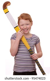 Portrait of ayoung girl holding a hockey stick isolated on white background