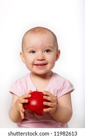 portrait of baby with apple