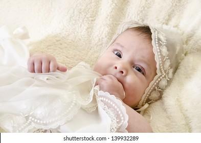 Portrait of baby biting hands
