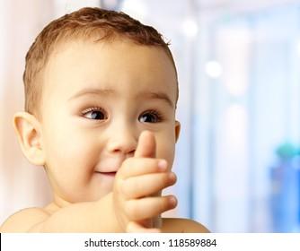 Portrait Of Baby Boy Extending Hand, indoor