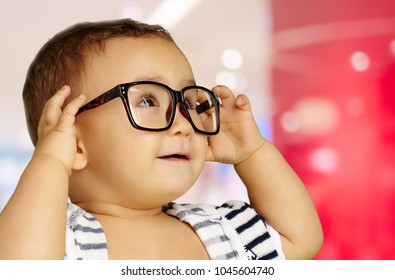 Portrait Of Baby Boy Wearing Eyeglasses at a mall