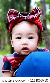 Portrait of a baby girl  asian  close-up shoulder father in nature and cute adorable.