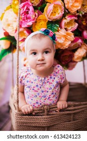 Portrait of baby girl in Balloon of flowers background