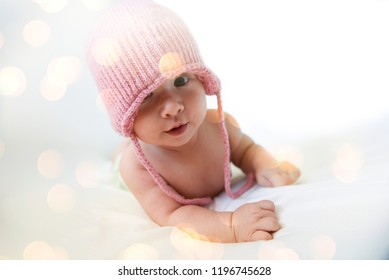 Portrait of baby girl in a pink warm hat