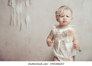 Portrait baby girl with vintage dress boho style