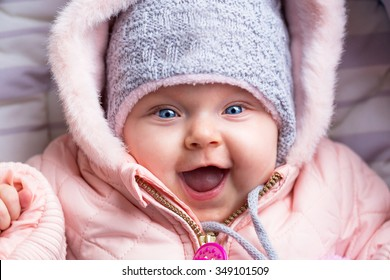 Portrait of baby girl in winter jacket and hat