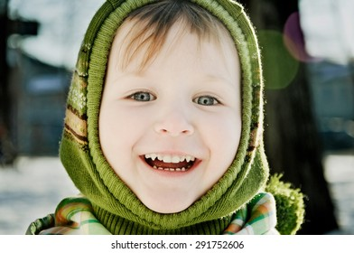 portrait of baby girl in winter on the street