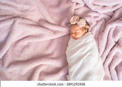 portrait of baby infant sleeping on soft furry bed in studio.