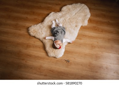 Portrait of a baby lying on a blanket of wool. close-up