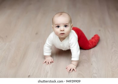 Portrait of baby on parquet at home