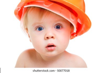 Portrait of a baby in the orange hardhat
