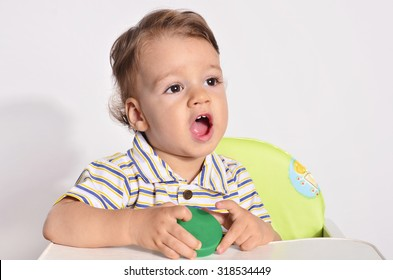 Portrait of a baby, toddler with big black eyes looking playing talking, screaming