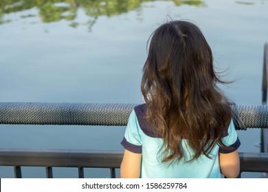 Portrait back child girl Asian alone look river