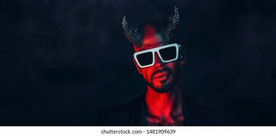 A portrait of a bad demon in sunglasses. Horror movie, nightmare. Halloween.