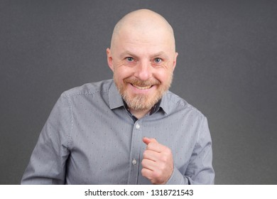 Portrait of a bald and bearded happy man
