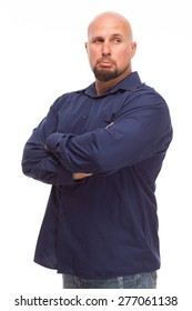 Portrait of bald, handsome young man isolated on white background. Caucasian man with beard looking sad with arms crossed.