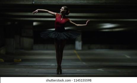 Portrait of ballet dancer dancing in an underground car park