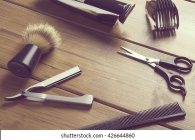 portrait of barber tools on wood top / essentials tools for barber