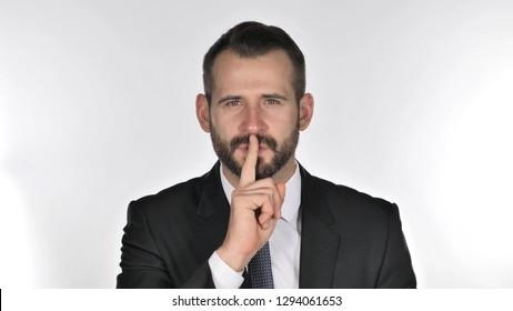 Portrait of Beard Businessman Gesturing  Silence, Finger on Lips