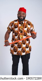 Portrait of bearded black African man dressed in cultural attire