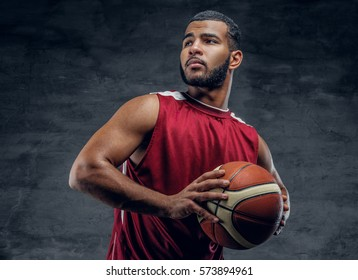Portrait of a bearded black man holds a basket ball.