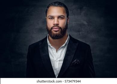 Portrait of bearded black man in a wool suit.