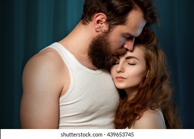 Portrait of a bearded, brutal guy and very beautiful girl