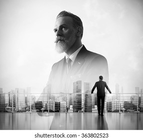Portrait of bearded businessman and panoramic view a city on the background. Double exposure.