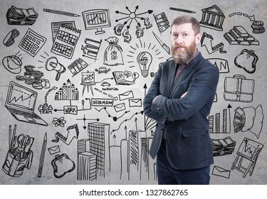 Portrait of bearded businessman presenting his business plan drawn on a concrete wall