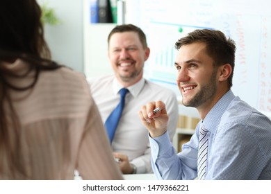 Portrait of bearded businessman sitting in company modern office and discussing with colleagues important contract or strategy. Biz meeting concept. Blurred background