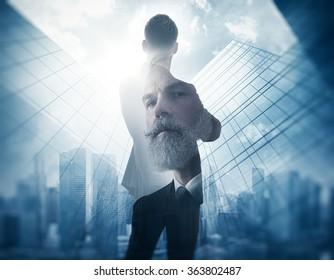 Portrait of bearded gentleman in suit. Double exposure skyscraper on the background.