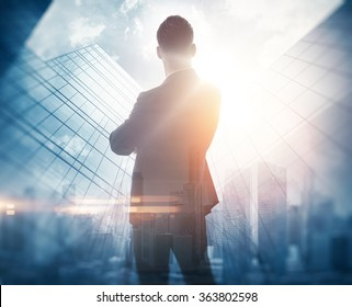 Portrait of bearded gentleman in suit. Double exposure skyscraper on the background. Visual effects.