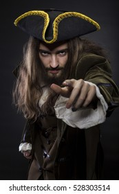 portrait of bearded and hairy pirate pointing into the viewer, shallow DOF