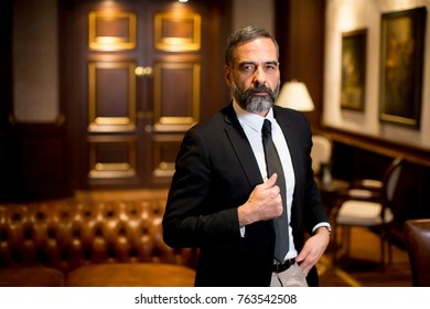 Portrait of bearded handsome middle-aged businessman