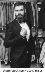 Portrait of bearded hipster man trying on tuxedo. Handsome stylish bearded man. Male beard and mustache. Bearded man in suit and bow-tie. Men's beauty, fashion. Sexy male, long beard. Black and white.