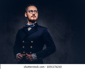 Portrait of a bearded male in glasses and antique suit on a dark
